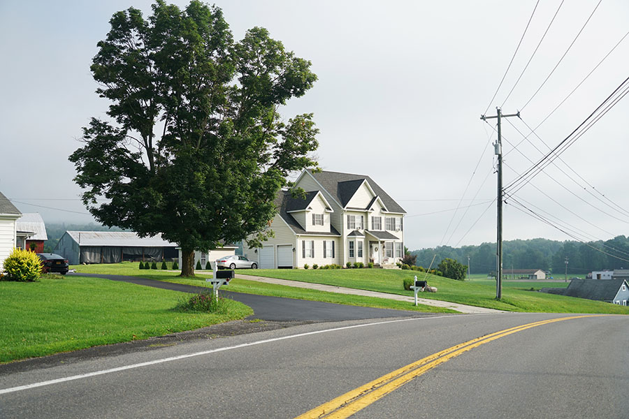 Hudson NC - View Of Empty Road And Two Story House In Hudson North Carolina
